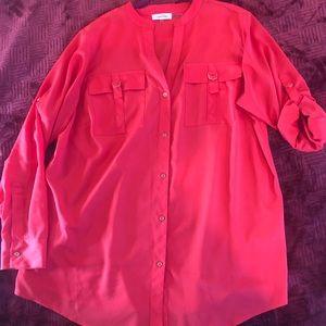 Button front blouse featuring split neckline.